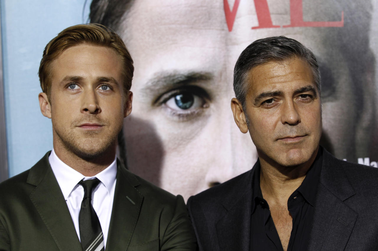 "FILE - In this Sept. 27, 2011 file photo, director, writer, and cast member George Clooney, right, and cast member Ryan Gosling pose together at the premiere of ""The Ides of March"", in Beverly Hills, Calif. Clooney and Gosling both received multiple nominations for Golden Globe awards on Thursday, Dec. 15, 2011. Gosling was nominated for best actor in a motion picture drama for his role in ""The Ides of March,"" and best actor in a comedy film for his role in ""Crazy, Stupid Love."" Clooney was nominated for best actor in a motion picture drama for his role in ""The Descendants,"" and as best director for ""The Ides of March."" (AP Photo/Matt Sayles, file)"