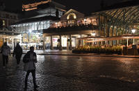 A view across a sparsely crowded Covent Garden in central London, Saturday, Oct. 31, 2020. Earlier Saturday British Prime Minister Boris Johnson announced England will start a monthlong lockdown next week. Johnson says the new measures will begin Thursday and last until Dec. 2. (AP Photo/Alberto Pezzali, Pool)