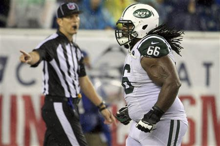 New York Jets Willie Colon runs off the field after being ejected for fouling an official in the fourth quarter against the New England Patriots during their NFL AFC East football game in Foxborough, Massachusetts, September 12, 2013. REUTERS/Dominick Reuter