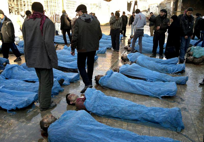 This citizen journalism image provided by Aleppo Revolution Against Assad's Regime which has been authenticated based on its contents and other AP reporting, shows dead bodies on a street in Aleppo, Syria Tuesday, Jan. 29, 2013. Syrian activists say at least 65 bodies, some of them with their hands tied behind their back, found on a river bank in the northern city of Aleppo. (AP Photo/Aleppo Revolution Against Assad Regime)