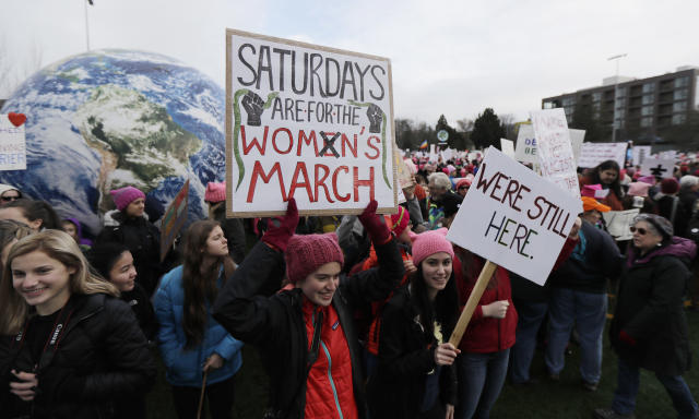 <p>A woman holds as sign as she takes part in a Women's March in Seattle, Saturday, Jan. 20, 2018. (Photo: Ted S. Warren/AP) </p>