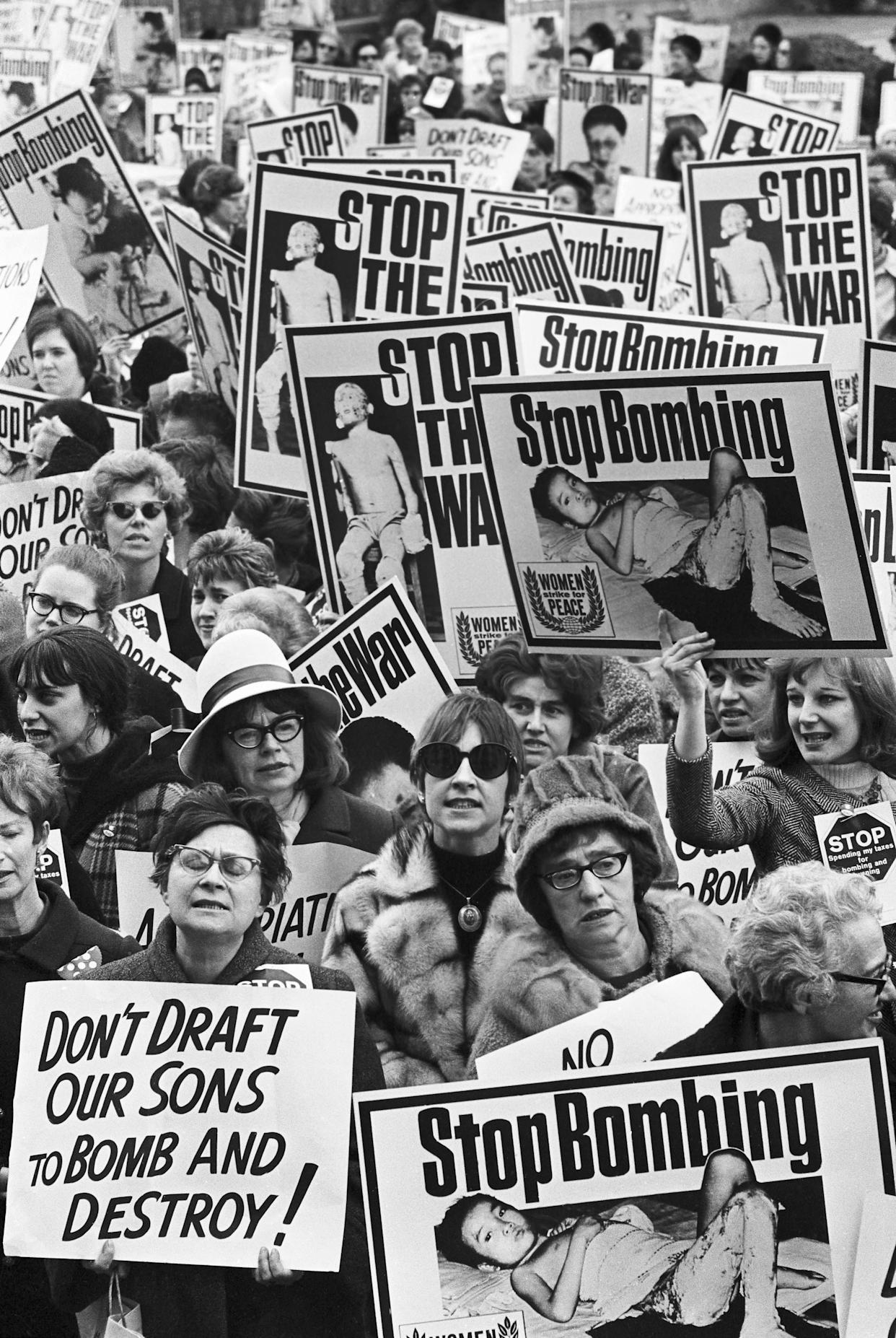 Carrying graphically illustrated anti-Vietnamese war posters, members of the 'Women's Strike for Peace' push their way to the doors of the Pentagon Building on Feb. 16, 1967. The main doors of the building were locked for 30 minutes, as the women stormed the doors in an effort to gain entrance. This photo is a close-up of the group.