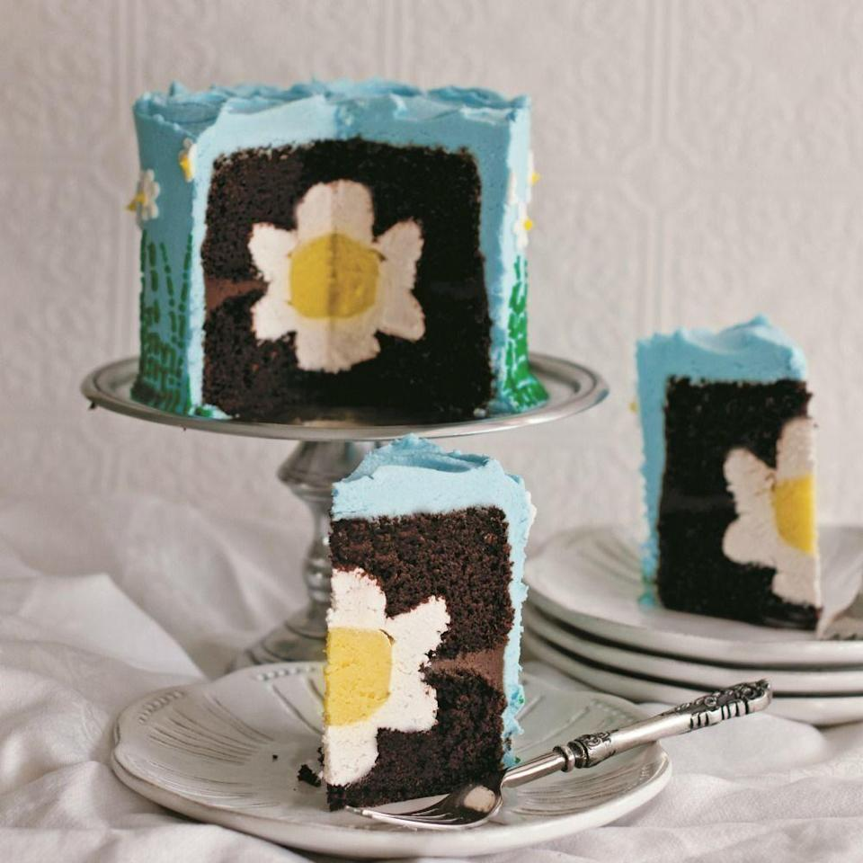 """<p>This cake is hiding a surprise inside, just like your Easter eggs.</p><p>Get the recipe from <a href=""""https://www.delish.com/cooking/recipe-ideas/recipes/a22695/daisy-cake-recipe-del0314/"""" rel=""""nofollow noopener"""" target=""""_blank"""" data-ylk=""""slk:Delish"""" class=""""link rapid-noclick-resp"""">Delish</a>.</p>"""