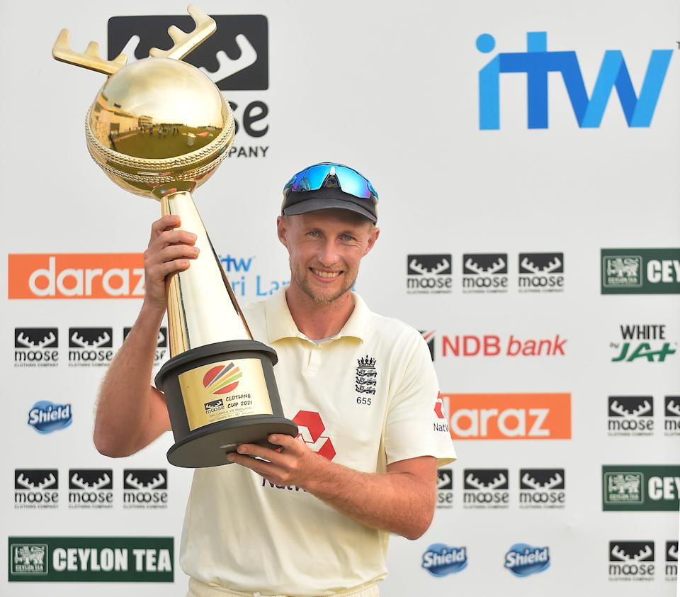 <p>Joe Root, the England captain holds the 'Moose Clothing Cup 2021' trophy</p> (ECB)