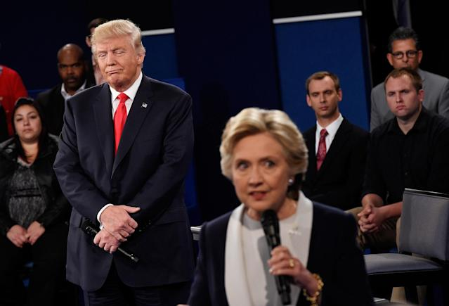 <p>Hillary Clinton speaks as Republican presidential nominee Donald Trump listens during the town hall debate at Washington University on Oct. 9, 2016 in St Louis, Mo. (Photo: Saul Loeb-Pool/Getty Images) </p>