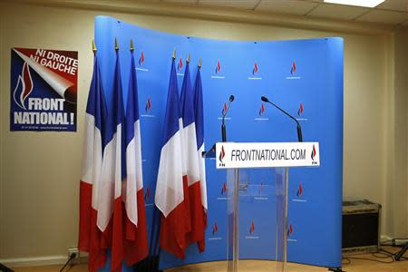 An empty podium is seen at the France's far-right National Front political party's headquarters during the first round in the French mayoral elections in Nanterre, March 23, 2014. REUTERS/Benoit Tessier