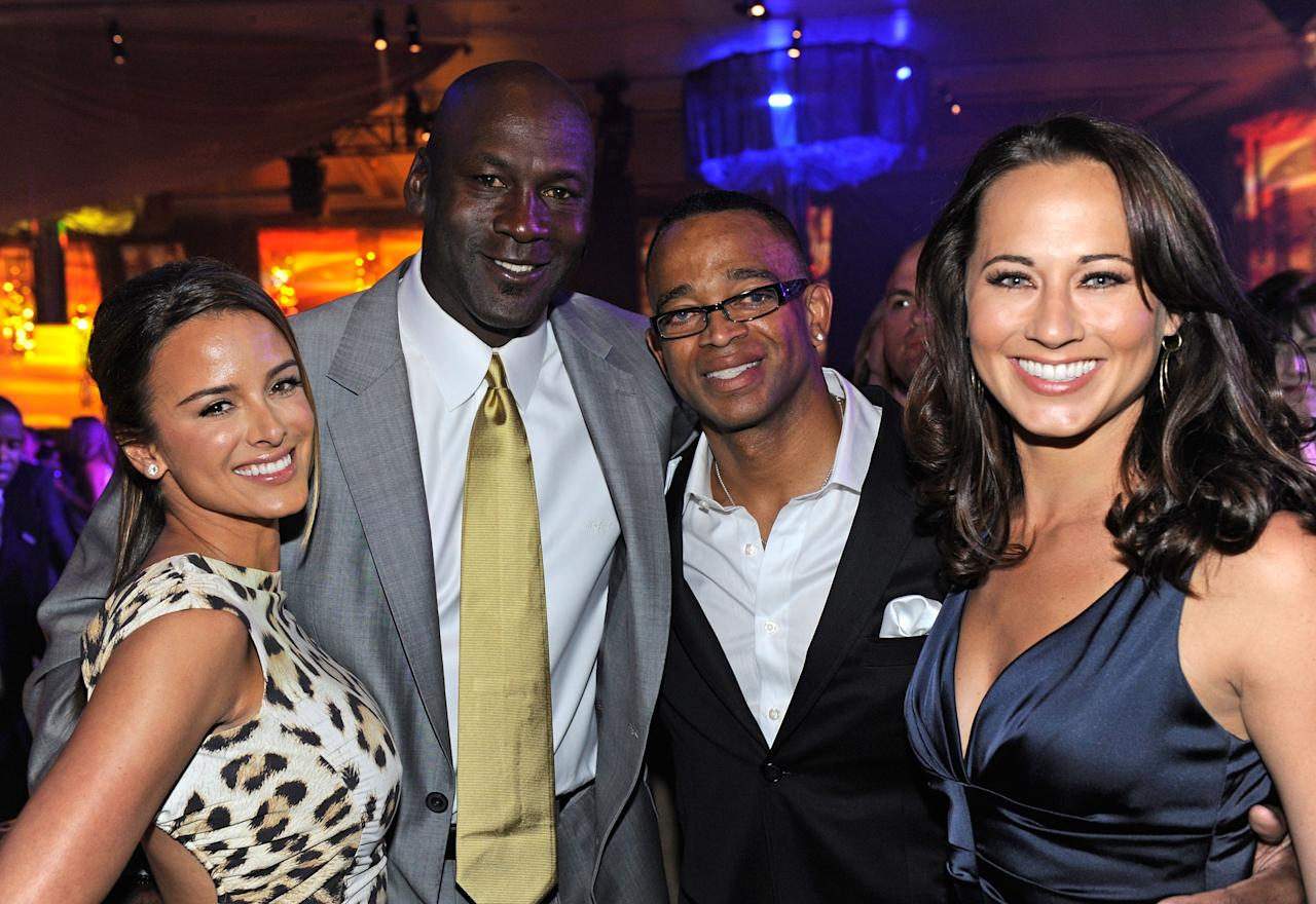 LAS VEGAS, NV - MARCH 30:  Model Yvette Prieto, Charlotte Bobcats owner Michael Jordan, Sportscaster Stuart Scott and Sandi Williams attend the 11th annual Michael Jordan Celebrity Invitational gala at the Aria Resort & Casino at CityCenter March 30, 2011 in Las Vegas, Nevada.  (Photo by Ethan Miller/Getty Images for MJCI)