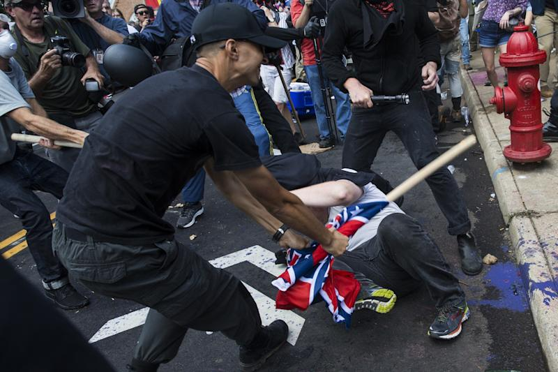 """A white supremacist beats a counter-protester at the Charlottesville """"Unite the Right"""" rally in August 2017. ProPublica <a href=""""https://www.huffingtonpost.com/entry/marines-investigating-active-duty-white-supremacist_us_5af0e157e4b0c4f19325ea94"""">identified the man in the photo</a> asU.S. Marine Corps Lance Cpl. Vasillios Pistolis. (Anadolu Agency via Getty Images)"""