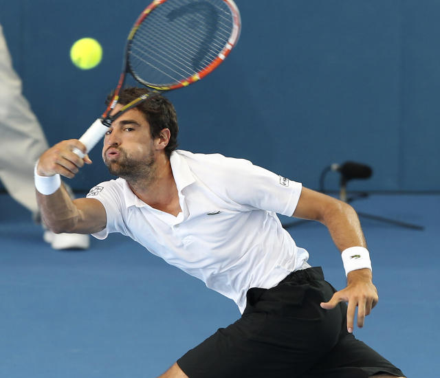 Jeremy Chardy of France plays a shot in his semifinal match against Roger Federer of Switzerland during the Brisbane International tennis tournament in Brisbane, Australia, Saturday, Jan. 4, 2014. (AP Photo/Tertius Pickard)