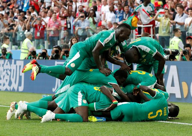 Soccer Football - World Cup - Group H - Poland vs Senegal - Spartak Stadium, Moscow, Russia - June 19, 2018 Senegal's M'Baye Niang celebrates scoring their second goal with team mates REUTERS/Grigory Dukor TPX IMAGES OF THE DAY