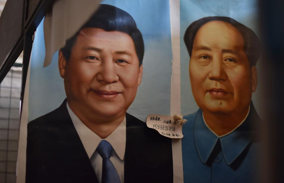 Painted portraits of Chinese President Xi Jinping and Mao Zedong at a market in Beijing.
