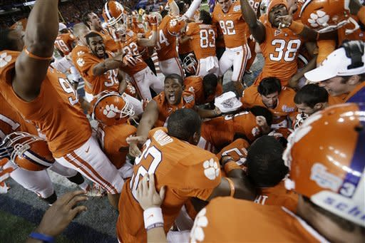 Clemson players pile up in the middle of the field after the Chick-fil-A Bowl NCAA college football game against LSU, Monday, Dec. 31, 2012, in Atlanta. Clemson won 25-24 on a field goal as time expired. (AP Photo/David Goldman)