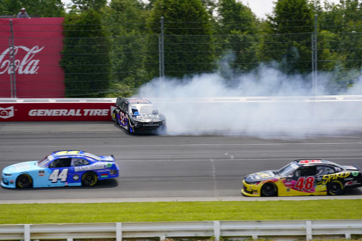 Josh Williams (92) hits the wall after spinning out going through turn one as Tommy Joe Martins (44) and Jade Buford (48) pass by during a NASCAR Xfinity Series auto race at Pocono Raceway, Sunday, June 27, 2021, in Long Pond, Pa. (AP Photo/Matt Slocum)