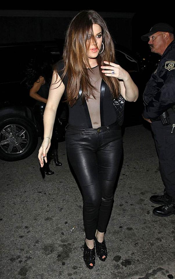 """11. Reality """"star"""" Khloe Kardashian -- in a navel-exposing mesh shirt and skintight leather pants -- at a Nicki Minaj post concert party in West Hollywood. (04/22/2011)"""