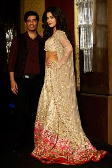 Manish Malhotra layered his sheer black sari over a red metallic ghagra