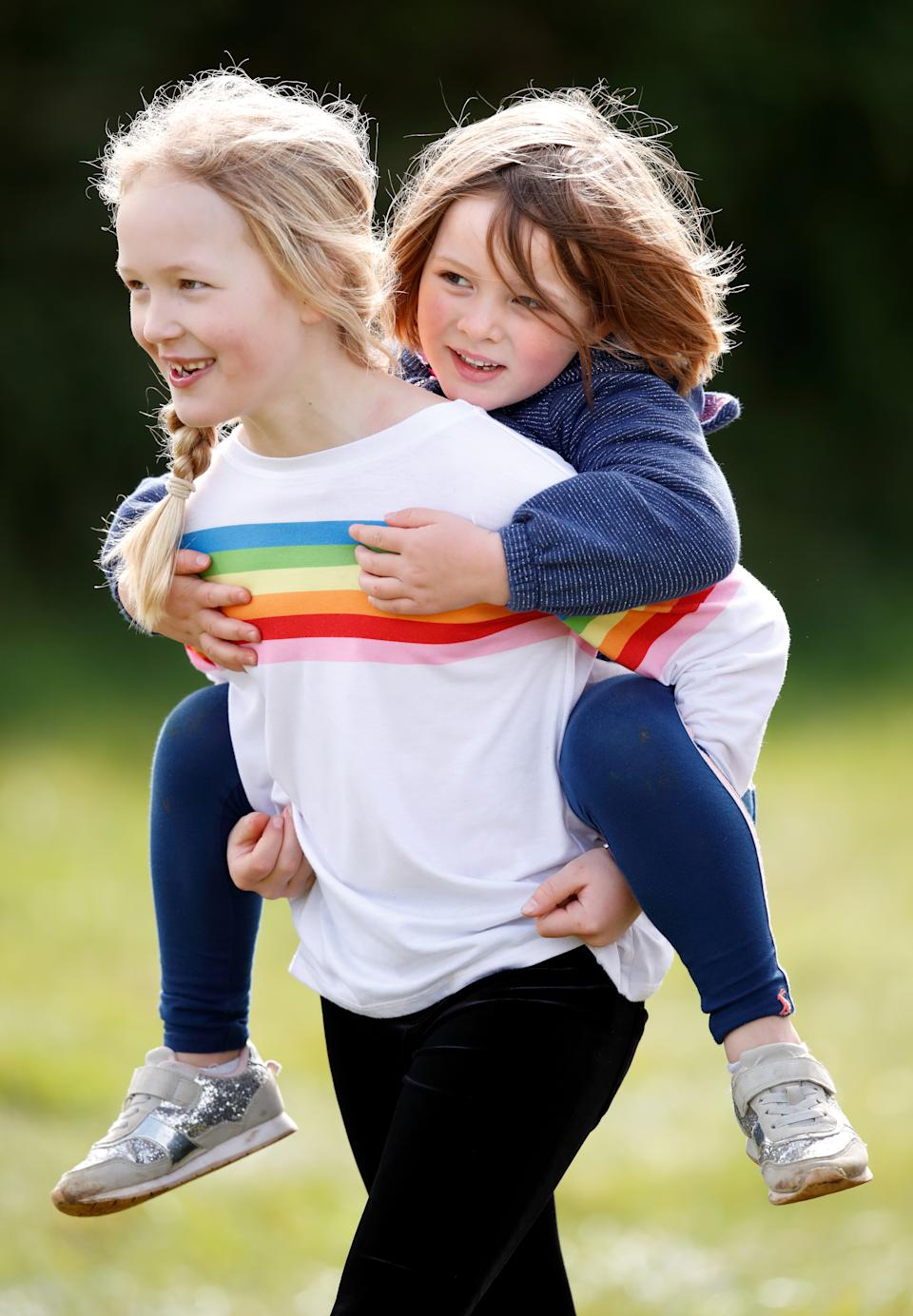 STROUD, UNITED KINGDOM - MARCH 23: (EMBARGOED FOR PUBLICATION IN UK NEWSPAPERS UNTIL 24 HOURS AFTER CREATE DATE AND TIME) Savanah Phillips gives her cousin Mia Tindall a piggyback as they attend the Gatcombe Horse Trials at Gatcombe Park on March 23, 2019 in Stroud, England. (Photo by Max Mumby/Indigo/Getty Images)