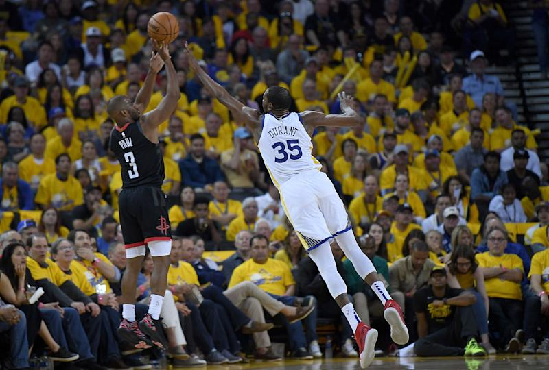 OAKLAND, CA - APRIL 28: Chris Paul #3 of the Houston Rockets shoots over Kevin Durant #35 of the Golden State Warriors during Game One of the Second Round of the 2019 NBA Western Conference Playoffs at ORACLE Arena on April 28, 2019 in Oakland, California. NOTE TO USER: User expressly acknowledges and agrees that, by downloading and or using this photograph, User is consenting to the terms and conditions of the Getty Images License Agreement. (Photo by Thearon W. Henderson/Getty Images)