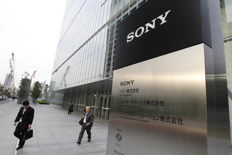 Office workers leave the headquarters of Sony Corp. in Tokyo Tuesday, April 10, 2012. Sony more than doubled Tuesday its projected annual loss to 520 billion yen ($6.4 billion), its worst red ink ever, due to a massive tax charge. (AP Photo/Koji Sasahara)