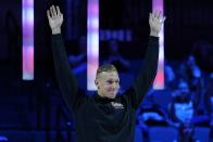 Caeleb Dressel reacts at the medal ceremony for the men's 50 freestyle during wave 2 of the U.S. Olympic Swim Trials on Sunday, June 20, 2021, in Omaha, Neb. (AP Photo/Charlie Neibergall)