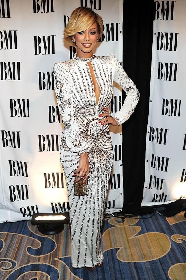 """Hip-hop star Keri Hilson is known for having an edgy sense of style. That's why we were utterly confused when the 28-year-old arrived at the BMI Pop Awards in Beverly Hills sporting helmet hair and a Mirco Giovannini crystal-encrusted white gown, both of which aged her drastically. Was she auditioning for a """"Dynasty"""" remake? Frazer Harrison/<a href=""""http://www.wireimage.com"""" target=""""new"""">WireImage.com</a> - May 17, 2011"""