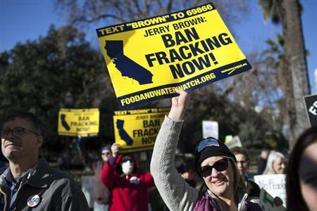 Woman protests fracking outside the State Capitol after Governor Brown delivered his State of the State address at the Capitol in Sacramento