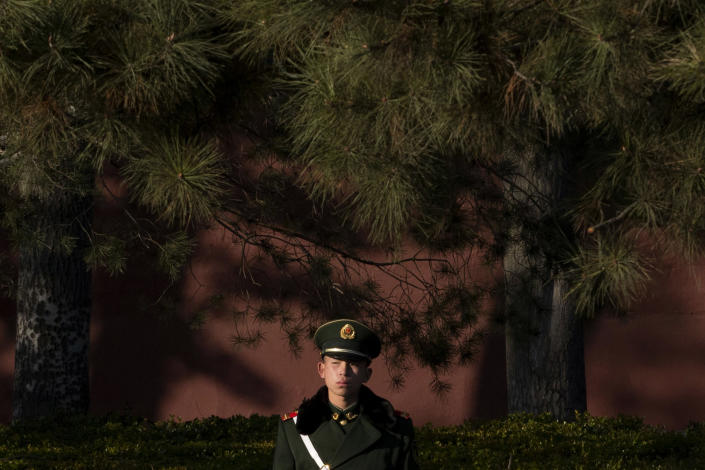 In this photo taken Tuesday, Nov. 12, 2013, a Chinese paramilitary policeman stands on duty in Beijing. China's plan to create a new security committee demonstrates Xi's success in cementing his authority as Communist Party leader, analysts said Wednesday, Nov. 13, 2013. Chinese academics for decades have advocated a body to oversee coordination among police, intelligence, military and other security organs, which have sometimes appeared out of step with each other or with the party's civilian leadership despite their emphasis on discipline and unity. (AP Photo/Ng Han Guan)