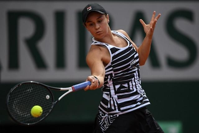 French Open champion Ashleigh Barty began her grass court season with victory in Birmingham (AFP Photo/CHRISTOPHE ARCHAMBAULT )