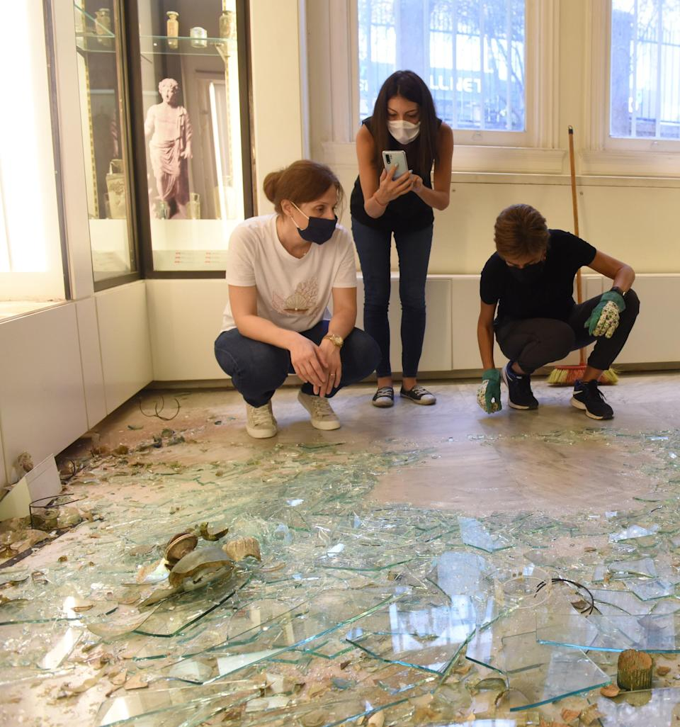 Experts assessing the damage after the removal of the case (British Museum/PA)