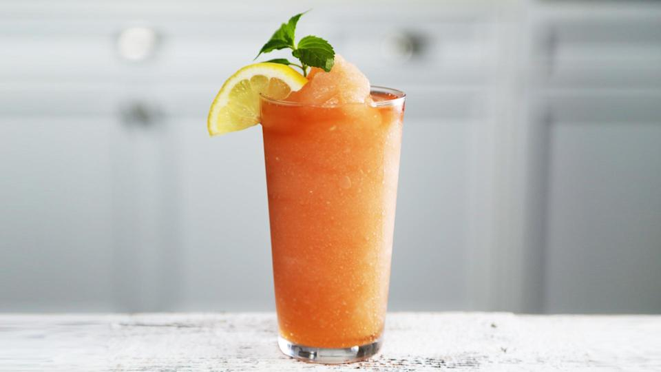 """<p>Say """"hello"""" to the ultimate summer sipper. For this cooling, boozy concoction, we took the idea of a <a href=""""https://www.myrecipes.com/summer-grilling/summer-drinks/flavored-iced-tea-recipes"""" rel=""""nofollow noopener"""" target=""""_blank"""" data-ylk=""""slk:sweet tea"""" class=""""link rapid-noclick-resp"""">sweet tea</a> and <a href=""""https://www.myrecipes.com/course/drink-recipes/favorite-vodka-cocktails"""" rel=""""nofollow noopener"""" target=""""_blank"""" data-ylk=""""slk:vodka"""" class=""""link rapid-noclick-resp"""">vodka</a> on the rocks to the next level by blending it into a delightful adult slushee. The recipe here serves 2, but is easily multiplied to produce more cocktails for friends (you can't sip on one of these beauties and not share). You can use store-bought sweet tea, or <a href=""""https://www.myrecipes.com/recipe/classic-sweet-tea"""" rel=""""nofollow noopener"""" target=""""_blank"""" data-ylk=""""slk:make your own"""" class=""""link rapid-noclick-resp"""">make your own</a> so that you can better control the level of of sweetness. </p>"""