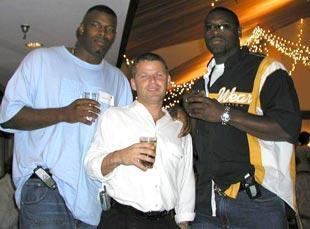 From left to right, Cornelius Green, Nevin Shapiro and Jamaal Green at an Axcess Sports agency function in 2003. Shapiro owned 30 percent of the agency with then-agent and current UFL commissioner Michael Huyghue.
