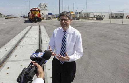U.S. Treasury Secretary Jack Lew speaks with journalists during a tour at the Port Miami on-dock rail facilities in Miami, Florida March 19, 2015. REUTERS/Javier Galeano