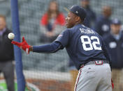 """Atlanta Braves prospect Ronald Acuna Jr., tosses the ball back to the pitcher during batting practice before the """"Future Stars"""" exhibition baseball game against the Atlanta Braves on Tuesday, March 27, 2018, in Atlanta. (Curtis Compton/Atlanta Journal-Constitution via AP)"""
