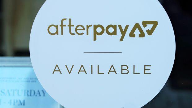 A logo for Afterpay in a store window in Sydney