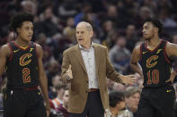 Cleveland Cavaliers head coach John Beilein, center, talks with Cleveland Cavaliers' Collin Sexton (2) and Darius Garland (10) in the first half of an NBA basketball game against the Atlanta Hawks, Wednesday, Feb. 12, 2020, in Cleveland. (AP Photo/Tony Dejak)