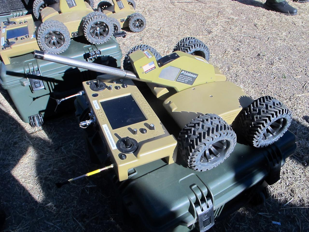 A wireless, camera-equipped robot is displayed by the U.S. Border Patrol during a briefing in Nogales, Ariz., Tuesday, Jan. 14, 2014. With more than 75 underground drug smuggling tunnels found along the border since 2008, mostly in California and Arizona, the U.S. Border Patrol is utilizing the robots to assist in their search. (AP Photo/Brian Skoloff)
