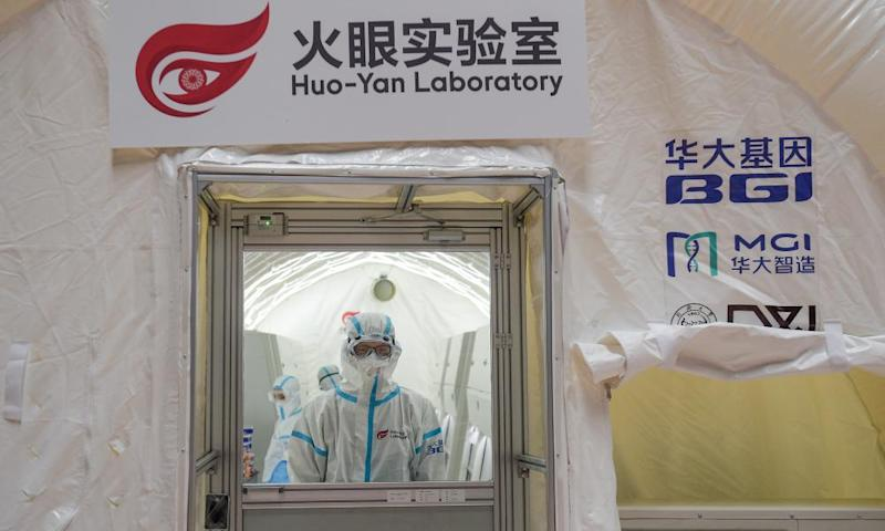 A mobile testing lab in Beijing using 14 automated Covid-19 testing machines provided by BGI