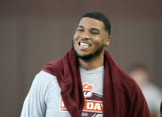 FILE - Christian Darrisaw smiles after completing a set of offensive line drills during Virginia Tech Pro Day in Blacksburg, Va., in this Friday, March 26, 2021, file photo. Darrisaw is a possible first round pick in the NFL Draft, April 29-May 1, 2021, in Cleveland. (AP Photo/Matt Gentry, File)