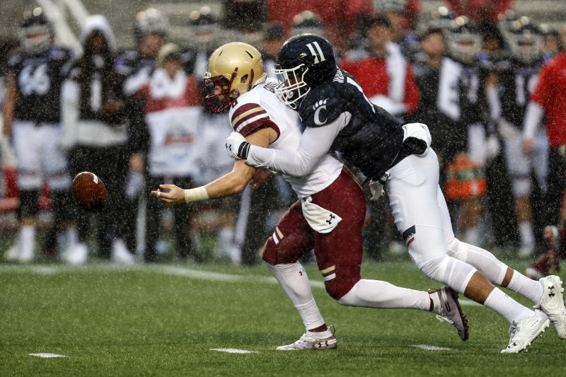 Boston College quarterback Dennis Grosel (6) fumbles the ball as he is tackled by Cincinnati linebacker Bryan Wright (11) during the first half of the Birmingham Bowl NCAA college football game Thursday, Jan. 2, 2020, in Birmingham, Ala. (Photo/Butch Dill)