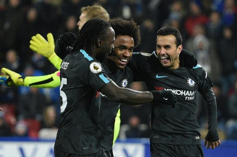 Chelsea's Pedro (R) celebrates with teammates after scoring a goal during their English Premier League match against Huddersfield Town, at the John Smith's stadium in Huddersfield, on December 12, 2017
