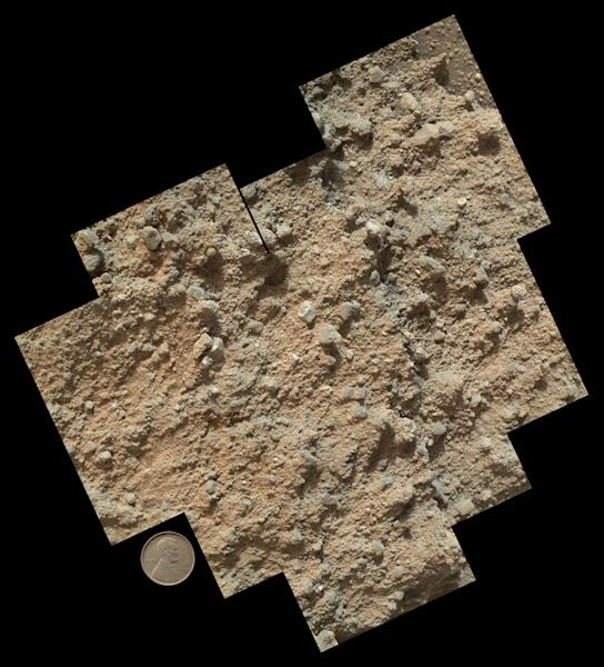"""This mosaic of nine images, taken by the Mars Hand Lens Imager camera on NASA's Mars rover Curiosity, shows detailed texture in a conglomerate rock bearing small pebbles and sand-size particles. The rock is at a location called """"Darwin,"""" inside"""