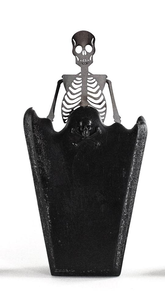 "<p>As the <a href=""https://www.popsugar.com/buy/Coffin-Skeleton-Candle-493479?p_name=Coffin%20Skeleton%20Candle&retailer=etsy.com&pid=493479&price=30&evar1=casa%3Aus&evar9=46667581&evar98=https%3A%2F%2Fwww.popsugar.com%2Fhome%2Fphoto-gallery%2F46667581%2Fimage%2F46667582%2FCoffin-Skeleton-Candle&list1=halloween%2Ccandles%2Challoween%20decor&prop13=api&pdata=1"" rel=""nofollow"" data-shoppable-link=""1"" target=""_blank"" class=""ga-track"" data-ga-category=""Related"" data-ga-label=""http://www.etsy.com/listing/618532695/coffin-skeleton-candle-halloween-candles"" data-ga-action=""In-Line Links"">Coffin Skeleton Candle</a> ($30, originally $35) melts, a detailed metal skeleton is revealed at the center, slowly emerging like something out of a spooky <a class=""sugar-inline-link ga-track"" title=""Latest photos and news for halloween"" href=""https://www.popsugar.com/Halloween"" target=""_blank"" data-ga-category=""Related"" data-ga-label=""https://www.popsugar.com/Halloween"" data-ga-action=""&lt;-related-&gt; Links"">Halloween</a> movie!</p>"