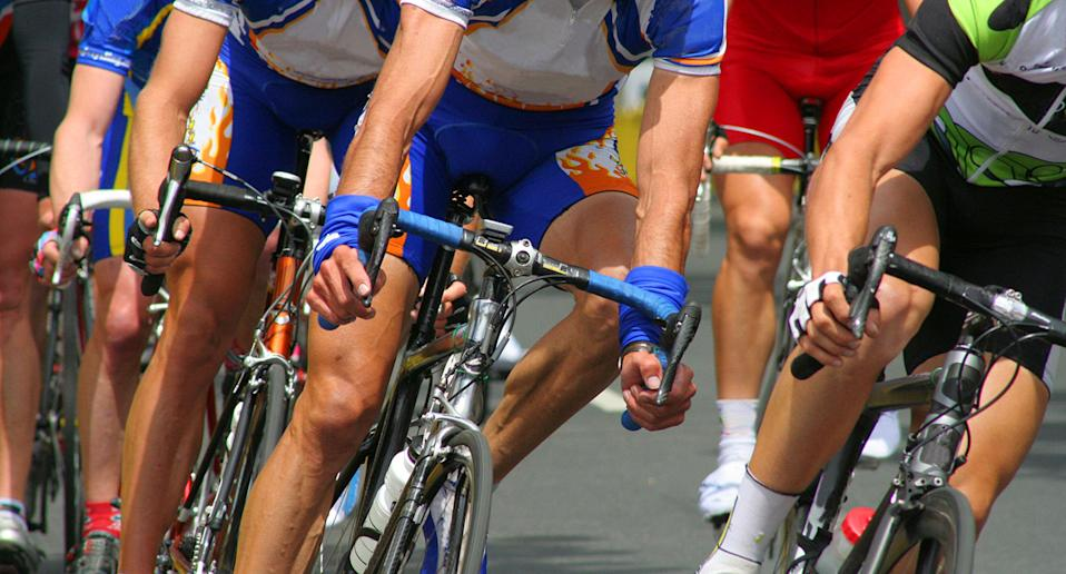 A number of cyclists ride in lycra.