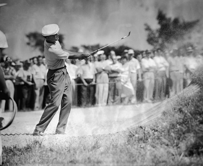 Ben Hogan hits out of a sand trap during the first round of the National Open in Oakmont, Pa., on June 9, 1953.