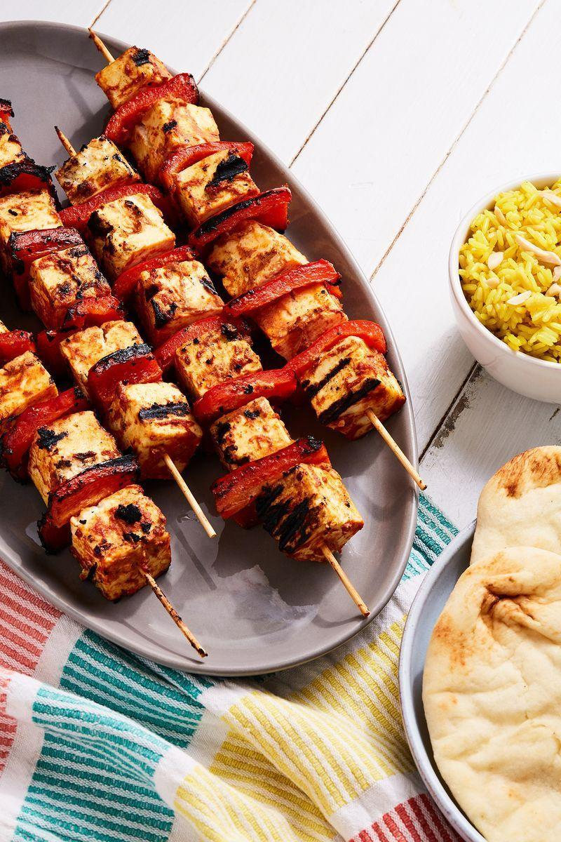 """<p>Paneer Tikka is an <a href=""""https://www.delish.com/uk/cooking/recipes/a29770946/easy-indian-butter-chicken-recipe/"""" rel=""""nofollow noopener"""" target=""""_blank"""" data-ylk=""""slk:Indian"""" class=""""link rapid-noclick-resp"""">Indian</a> dish made by skewering paneer <a href=""""https://www.delish.com/uk/food-news/a30961665/cheese-slicing-hack-potato-peeler/"""" rel=""""nofollow noopener"""" target=""""_blank"""" data-ylk=""""slk:cheese"""" class=""""link rapid-noclick-resp"""">cheese</a> which has been marinated in yoghurt and spices. Traditionally done in a tandoor, you get the same effect by grilling these bad boys, along with some red peppers. </p><p>Get the <a href=""""https://www.delish.com/uk/cooking/recipes/a31095229/paneer-tikka/"""" rel=""""nofollow noopener"""" target=""""_blank"""" data-ylk=""""slk:Paneer Tikka"""" class=""""link rapid-noclick-resp"""">Paneer Tikka</a> recipe.</p>"""