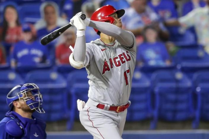 The Angels' Shohei Ohtani watches his solo home run as Blue Jays catcher Alejandro Kirk looks on April 9, 2021.