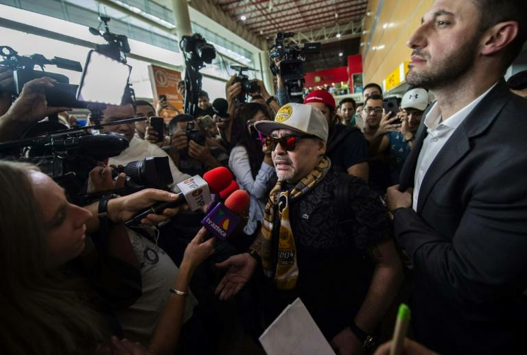 Diego Maradona was mobbed at Culiacan airport after he flew in to be presented as coach of Mexican second-division club Dorados