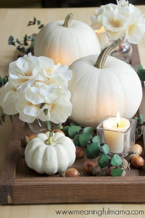 """<p>Prepare to impress your Thanksgiving guests: Housed together within a wooden tray, white pumpkins quickly transform into a stunning fall centerpiece. </p><p><strong>Get the tutorial at <a href=""""https://meaningfulmama.com/contemporary-fall-centerpiece-idea-with-white-pumpkins.html"""" rel=""""nofollow noopener"""" target=""""_blank"""" data-ylk=""""slk:Meaningful Mama"""" class=""""link rapid-noclick-resp"""">Meaningful Mama</a>.</strong></p><p><a class=""""link rapid-noclick-resp"""" href=""""https://go.redirectingat.com?id=74968X1596630&url=https%3A%2F%2Fwww.walmart.com%2Fsearch%2F%3Fquery%3Dwooden%2Btrays&sref=https%3A%2F%2Fwww.thepioneerwoman.com%2Fhome-lifestyle%2Fdecorating-ideas%2Fg36664123%2Fwhite-pumpkin-decor-ideas%2F"""" rel=""""nofollow noopener"""" target=""""_blank"""" data-ylk=""""slk:SHOP WOODEN TRAYS"""">SHOP WOODEN TRAYS</a></p>"""