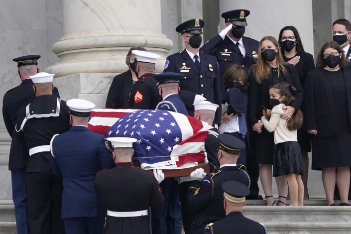 "Logan Evans and his sister Abigail Evans, along with their mother Shannon Terranova, watch as the casket of their father, slain U.S. Capitol Police officer William ""Billy"" Evans, arrives on Capitol Hill in Washington, Tuesday, April 13, 2021. Evans, 41, who served for 18 years on the Capitol Police force, was killed April 2, when a vehicle rammed into him and another officer during an attack at a security barricade, will lie in honor in the Rotunda. (AP Photo/Susan Walsh)"