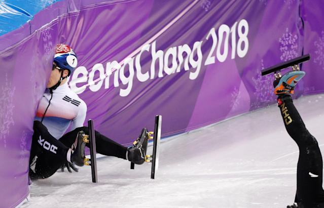 Short Track Speed Skating Events - Pyeongchang 2018 Winter Olympics - Men's 500m Quarterfinal - Gangneung Ice Arena - Gangneung, South Korea - February 22, 2018 - Han Tianyu of China and Seo Yi-ra of South Korea crash. REUTERS/John Sibley TPX IMAGES OF THE DAY