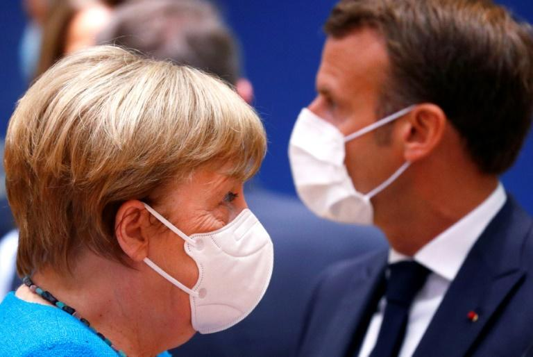Germany's Chancellor Angela Merkel and France's President Emmanuel Macron expressed cautious optimism for a deal as talks resumed